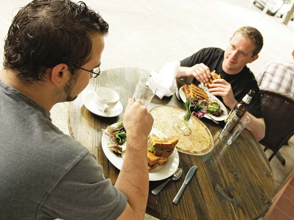 Chefs Tyler Reynolds, left, and Jeff Vance on the patio at Sante. - YOUNG KWAK