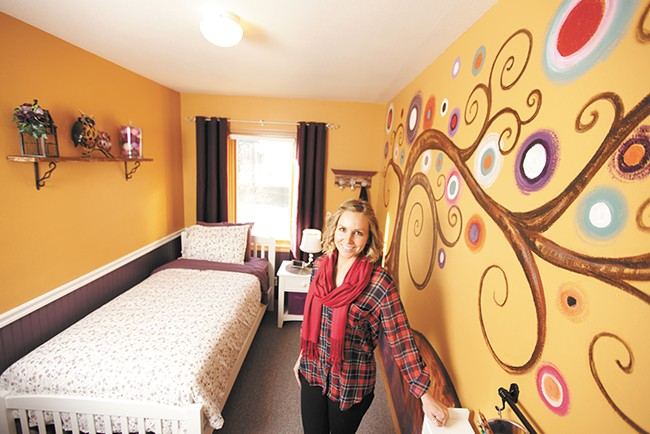 Christina Hull in one of the Children's Village's newly decorated rooms. The nonprofit aims to double its capacity to serve up to 200 North Idaho kids who need a safe place to stay. - YOUNG KWAK
