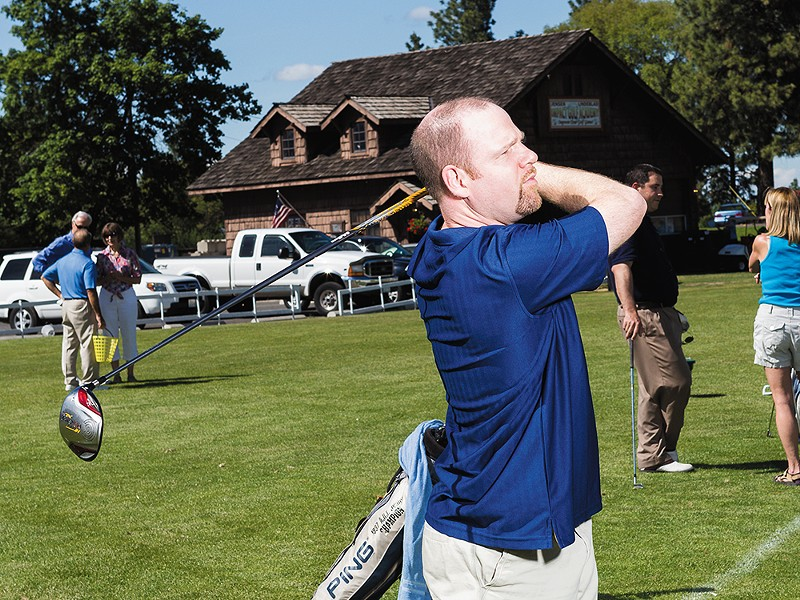 Clint Preston practicing on the driving range at Indian Canyon Golf Course. - STEPHEN SCHLANGE