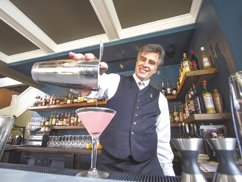 Clover bartender John Tindley pours a cocktail from the new restaurant's expansive drink list. - JEFF FERGUSON