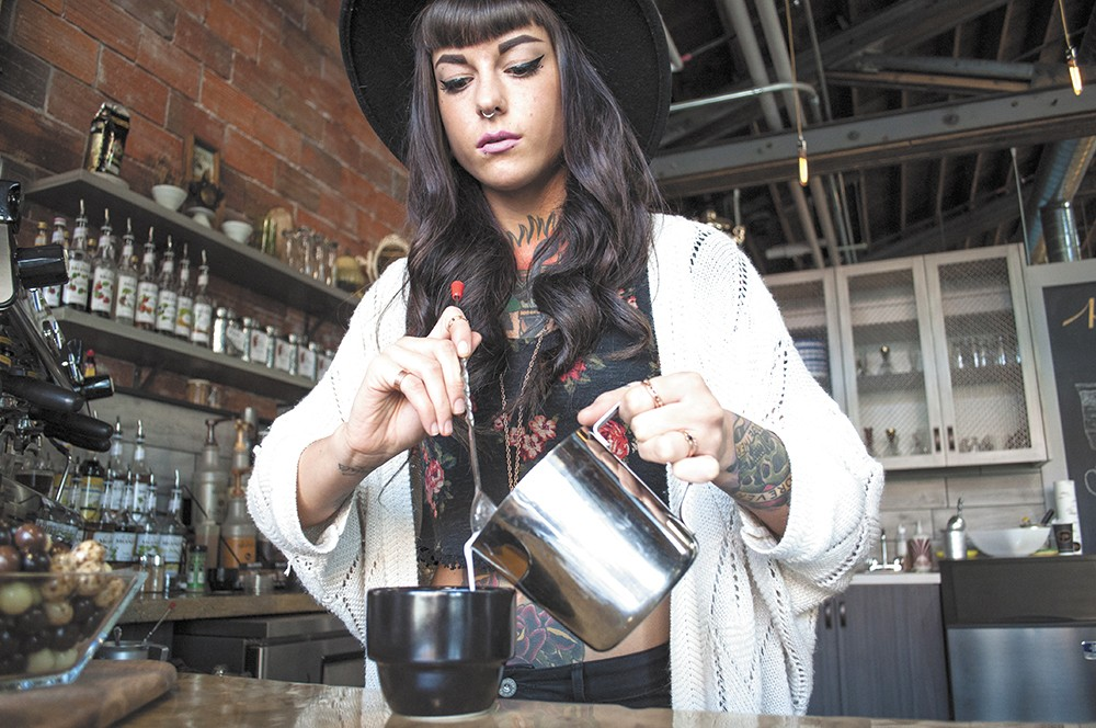 Coffee artisan Allie-Marie Evans pours steamed milk at Cafe Affogato. - SARAH WURTZ