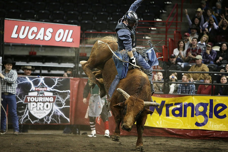 Colby Reilly, of Ephrata, Wash., rides W1 Buckey during the Championship Round. He rode 7.79 seconds before falling off the bull. - YOUNG KWAK