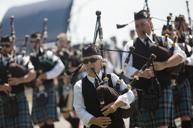 Columbia Regional Pipe Band member Judy Morrison, front, performs during the opening ceremonies. - YOUNG KWAK