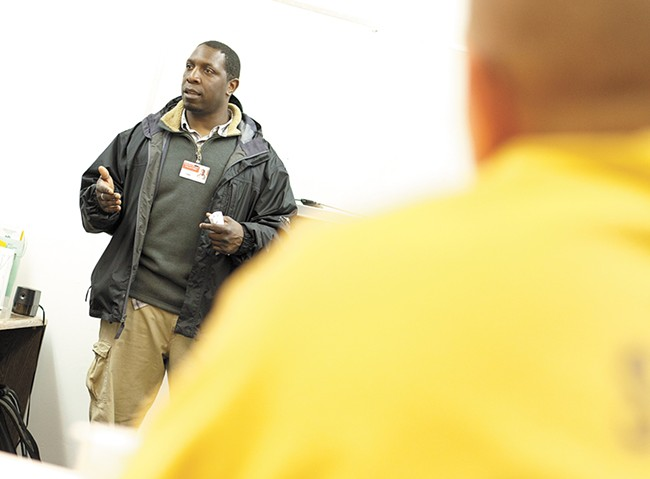 Community Minded Enterprises in-person assister Robert Martin talks about the benefits of having health insurance during a class at Geiger Corrections Center. - YOUNG KWAK