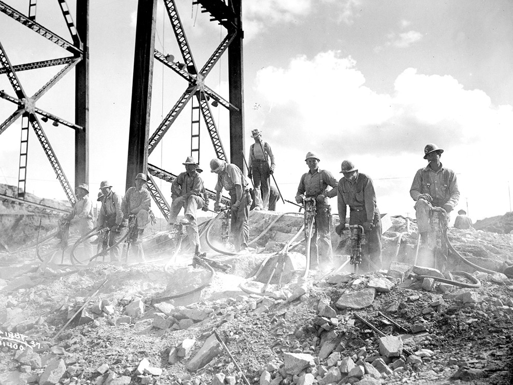 Construction of the Grand Coulee Dam took eight years and claimed 77 lives. - CHARLES LIBBY PHOTO/NORTHWEST MUSEUM OF ARTS