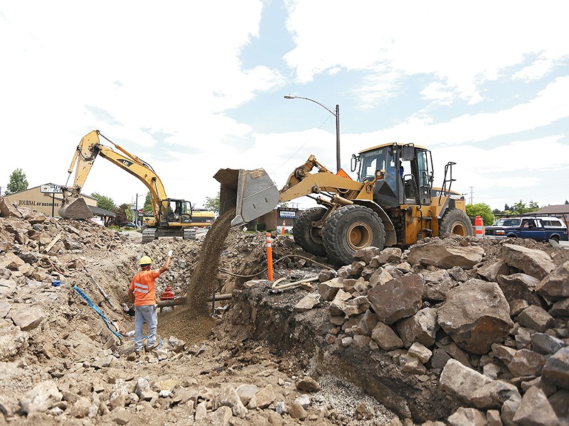 Crews are currently replacing a water main below Third Avenue near Division Street. - YOUNG KWAK