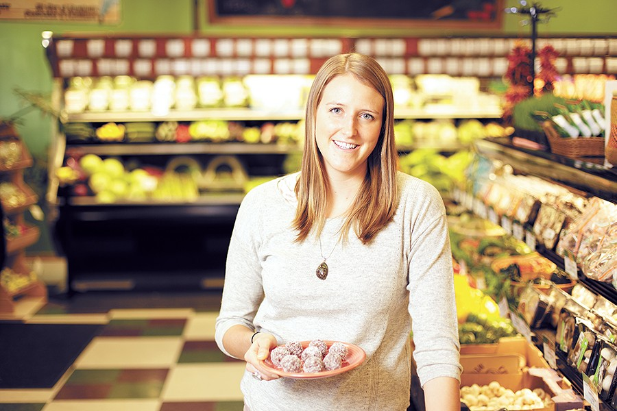 Darci Barman with a plate of cranberry pecan energy balls at Pilgrim's Market in Coeur d'Alene. - YOUNG KWAK