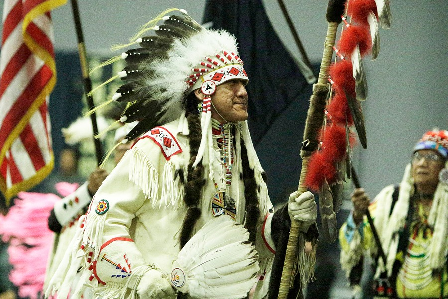 Dave BrownEagle, of the Spokane Tribe and Ho-Chunk Nation, leads the opening procession while carrying an eagle staff. - YOUNG KWAK