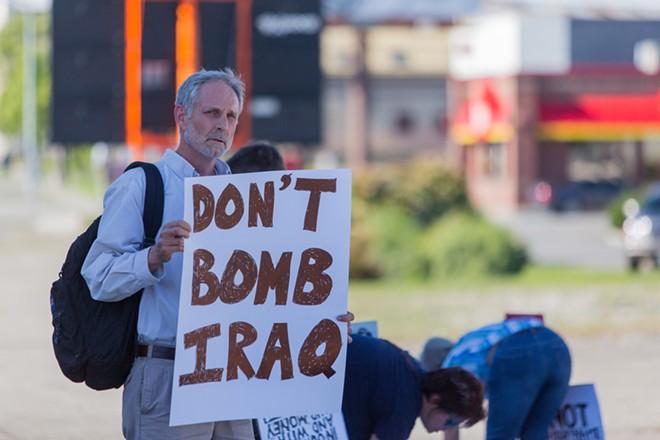 David Brookbank protests against the threat of bombing Iraq. - MATT WEIGAND