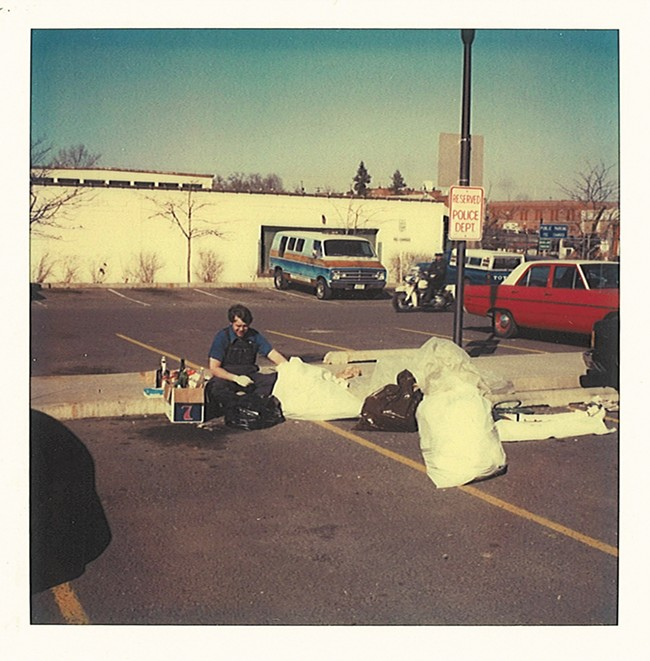Detective Brian Breen going through the - contents of Linda's garbage on March 14, 1981 in the parking lot of the public safety building.