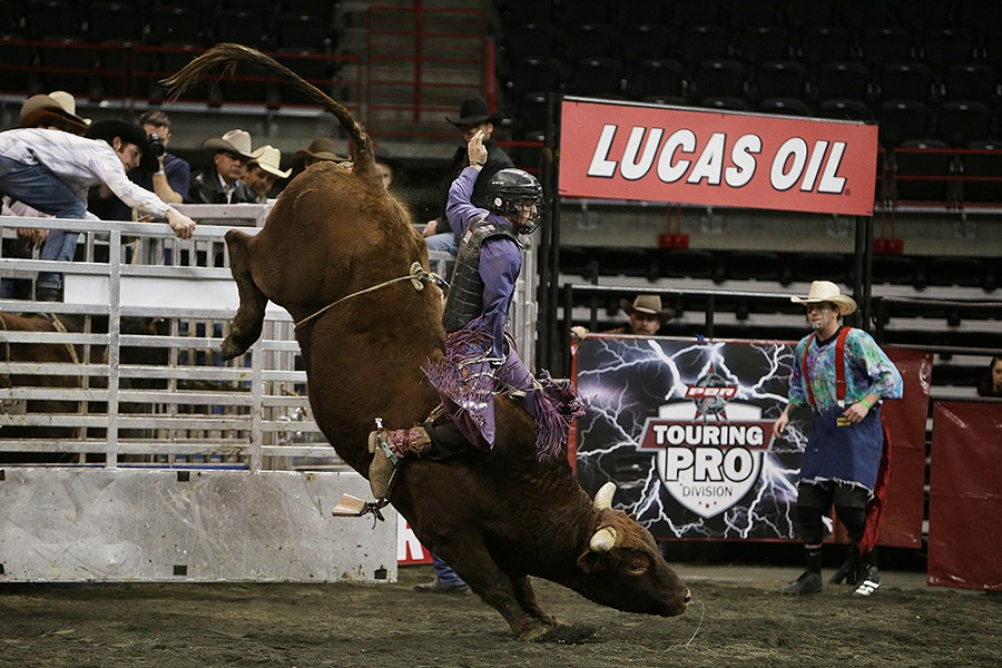 Diego Benedetti, of Eagle, Idaho, rides W5 Buck Off, during the Championship Round on Saturday. He rode 2.32 seconds before falling off the bull. - YOUNG KWAK