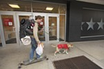 Dillon Green skates behind his mixed breed dog, Katara, past Macy's in downtown Spokane on Sept. 26.