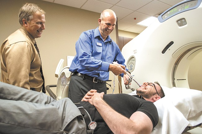 Dr. Frank Lamm (left), a radiation oncologist at Spokane CyberKnife, has treated about a dozen patients this year. - SARAH WURTZ