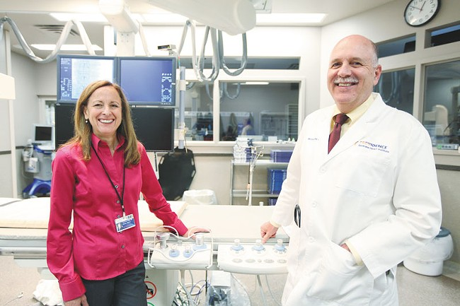 Dr. Katherine Tuttle and Dr. Michael Ring at a Sacred Heart catheterization lab. They're looking for local patients to help study a new treatment for high blood pressure. - YOUNG KWAK