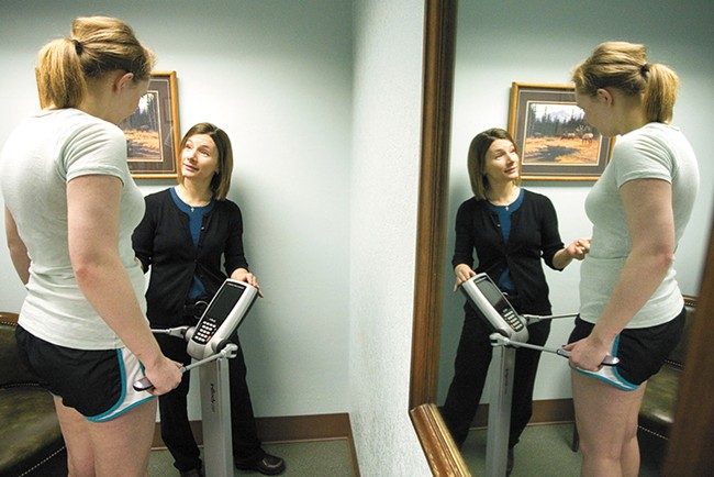 Dr. Rayme Geidl assesses body fat and muscle mass at Moscow Medical. - GEOFF CRIMMINS