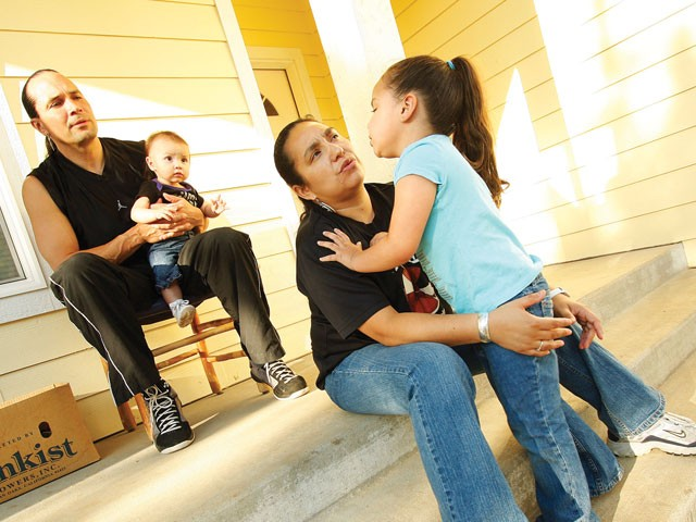 Duane Garvais and LoVina Louie, shown with daughters North Star, 3, and Dolly, 7 months, are part of an emerging trend of home ownership among Native Americans - YOUNG KWAK