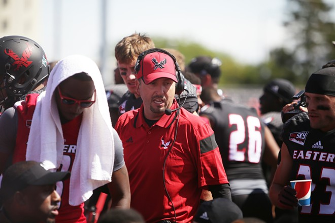 Eastern Washington head coach Beau Baldwin speaks with his team during the first half. - YOUNG KWAK