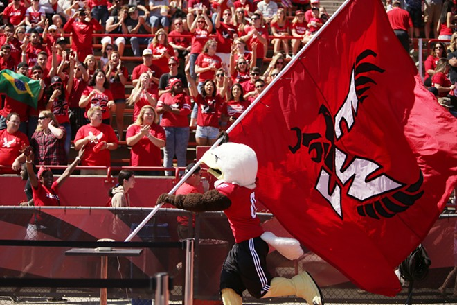 Eastern Washington mascot Swoop runs by fans before the game. - YOUNG KWAK