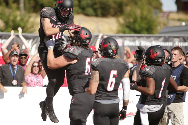 Eastern Washington offensive linesman Jake Rodgers, second from the left, lifts wide receiver Cooper Kupp, left, after Kupp receives a pass for a touchdown during the second half. - YOUNG KWAK