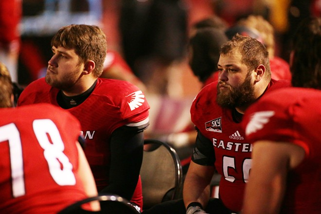 Eastern Washington players watch during the final minutes of the second half. - YOUNG KWAK