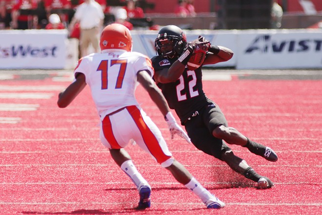 Eastern Washington running back Quincy Forte (22) runs the ball against Sam Houston State cornerback Tevin Creeks (17) during the first half. - YOUNG KWAK