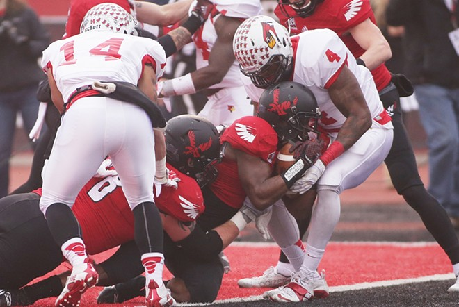 Eastern Washington running back Quincy Forte, right, scores a touchdown against Illinois State during the first half. - YOUNG KWAK