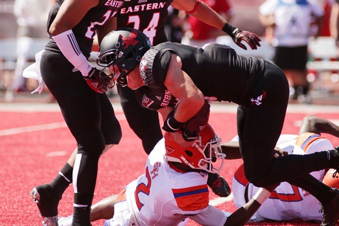 Eastern Washington wide receiver Cooper Kupp, top, is brought down by Sam Houston State safety Michael Wade (2) after a punt return during the first half. - YOUNG KWAK