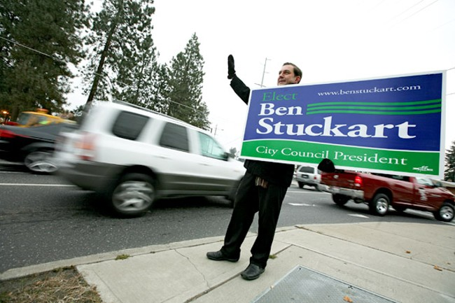 Ben Stuckart waves at passing motorists on Monday, Nov. 7. - YOUNG KWAK