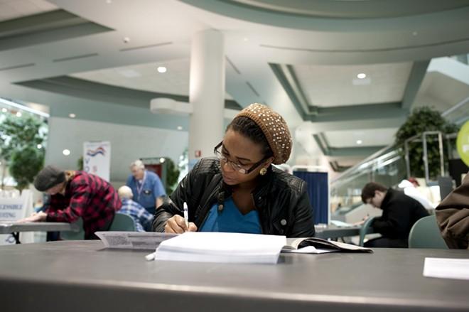 Rachena Webb, of Spokane, fills out her ballot at the STA building in downtown Spokane.