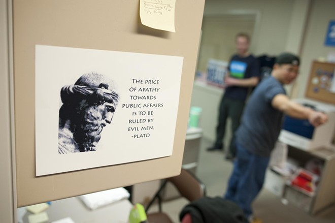 A flier hangs on a volunteer's cubicle at the Democratic HQ in Spokane.
