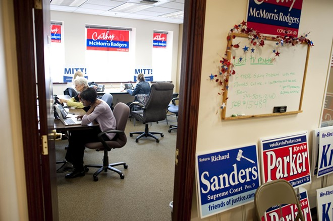 Volunteers call potential voters at the GOP Victory Center HQ in Spokane.