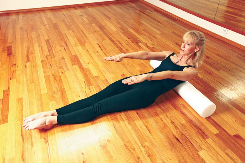 Elizabeth Jones-Boswell demonstrates an abdominal curl at her home Pilates studio. - YOUNG KWAK