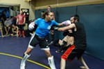 Elizabeth Phillips, left, punches while sparring with Ron Nance.