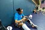 Elizabeth Phillips puts on a glove before sparring.