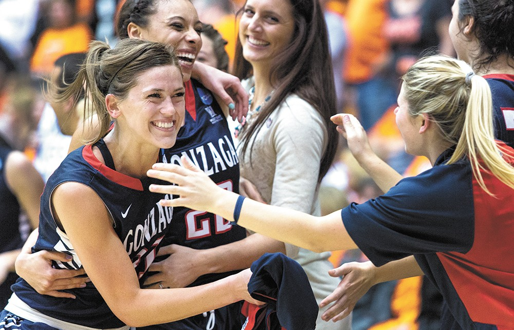 Elle Tinkle (left) and Shaniqua Nilles hug after upsetting Oregon State. - ELI FRANCOVICH