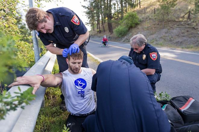 Emergency crews tend to the racer. - RYAN SULLIVAN