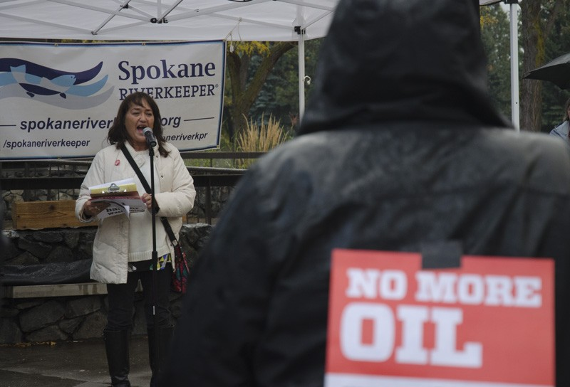"""Terri Anderson, with the Tenants Union of Washington State, addresses a rally against oil trains, noting many elderly, low-income or disabled residents live within the """"blast zone"""" for oil train derailments. - JACOB JONES"""