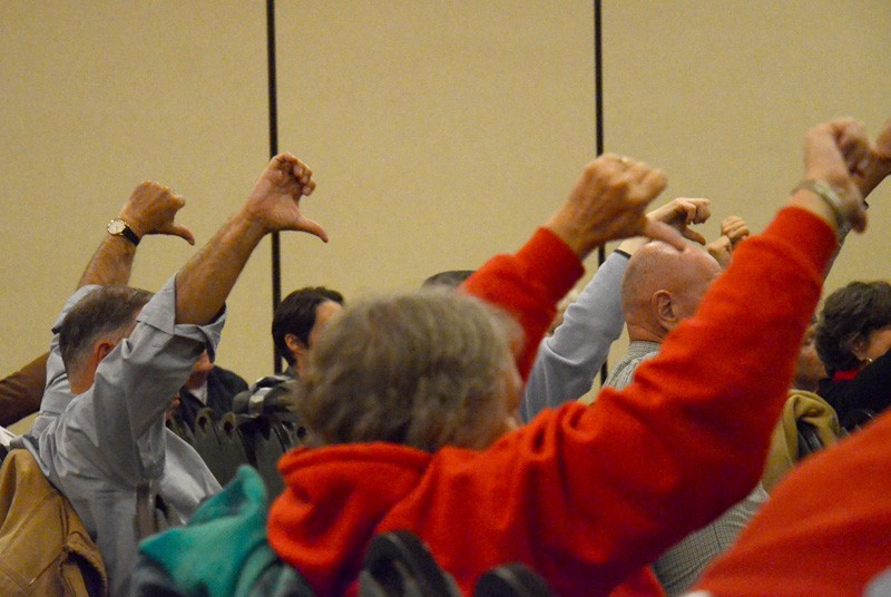The audience also displayed thumbs-down signs if they disagreed with testimony. - JACOB JONES