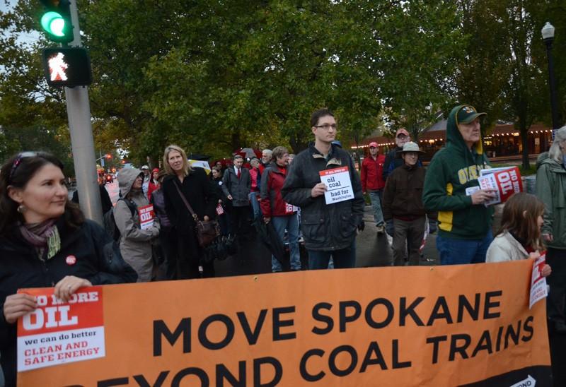 Anti-oil train citizens march through Riverfront Park. - JACOB JONES