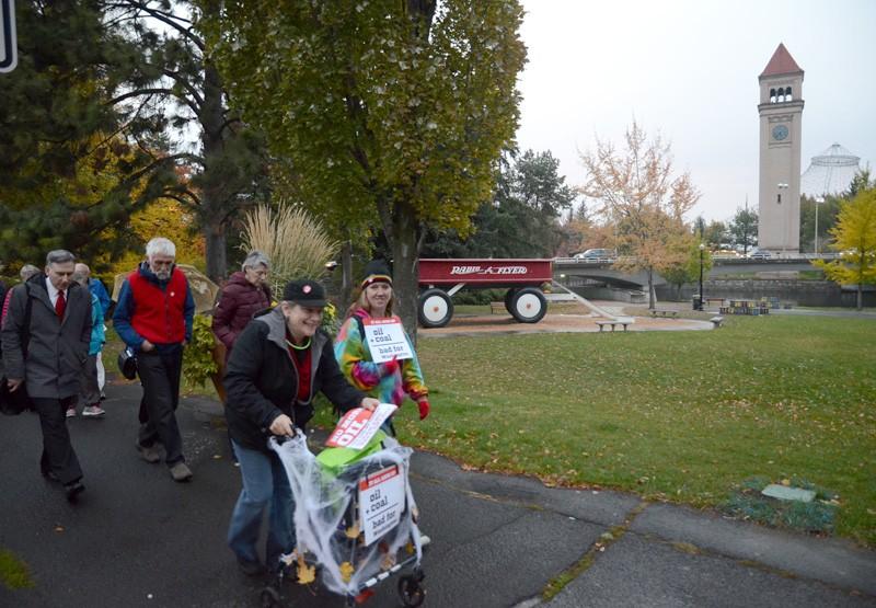 Citizens march through Riverfront Park. - JACOB JONES