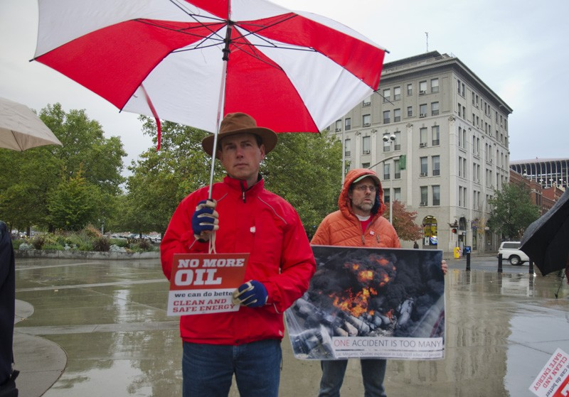 Some protestors carried photos of immense fires that broke out after recent oil train derailments. - JACOB JONES