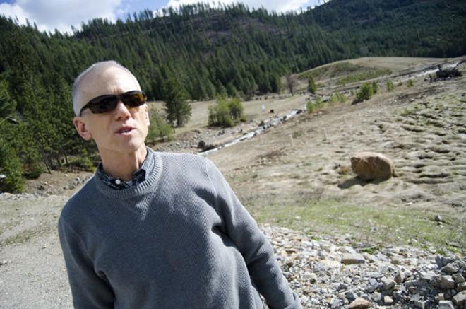 EPA team manager Bill Adams stands in a damaged flood plain near Wallace. - JACOB JONES