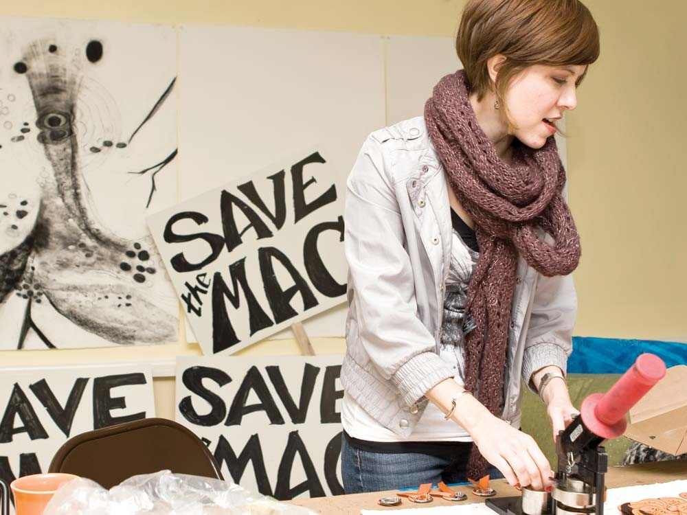 Erica Roberts at the home of Karen Mobley making Save the Mac buttons. - STEPHEN SCHLANGE