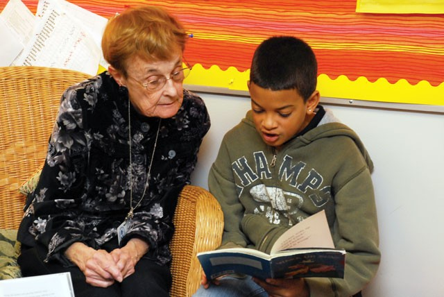 Esther Walter sits captivated by Dallas Winchester's reading at Hamblen Elementary in Spokane. - TAMMY MARSHALL