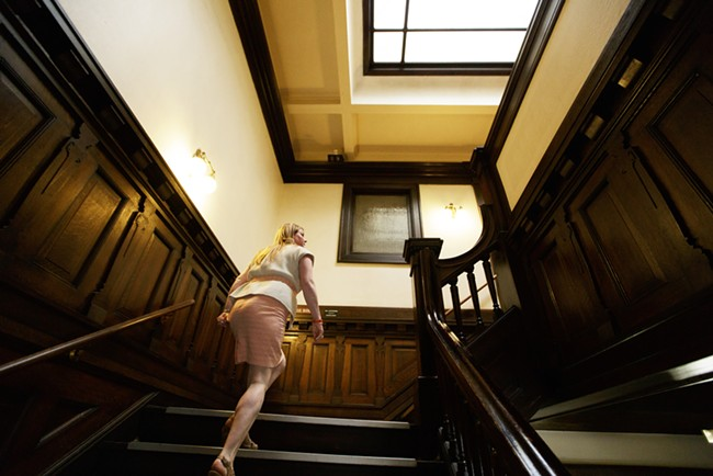 Events Manager Kimberley Scott walks up a flight of stairs at the Riverside Event Center. - YOUNG KWAK