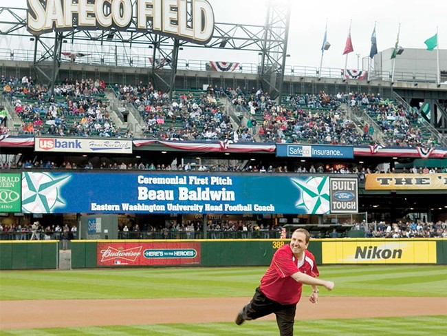 EWU football coach Beau Baldwin, throwing out the first pitch at the Mariners game last Saturday. - BEN VANHOUTEN