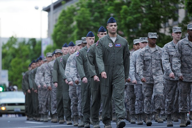 Fairchild Air Force Base personnel march. - YOUNG KWAK