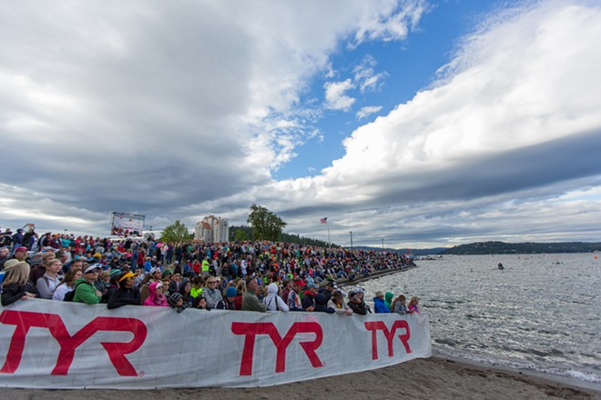 Family, friends and spectators watched as more than 2,000 competitors ran into the lake. - MATT WEIGAND