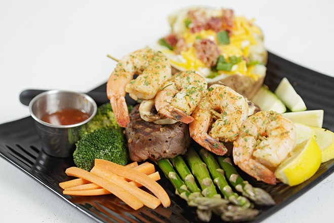 Filet mignon and grilled shrimp from Laguna Cafe, one of the more than 70 restaurants participating in Inlander Restaurant Week through Sunday. - YOUNG KWAK