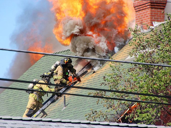 Firefighters battle the fire at a century-old home on Nora Avenue. - CITY OF SPOKANE FIRE DEPARTMENT